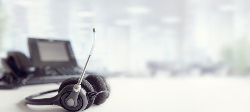 Headset headphones telephone on desk in call centre